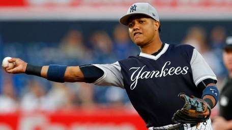 Starlin Castro of the Yankees throws for an