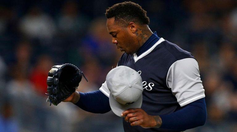 Aroldis Chapmanof the Yankees walks to the dugout