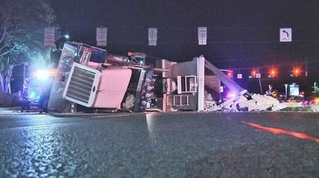 A tractor trailer overturned on eastbound Jericho Turnpike
