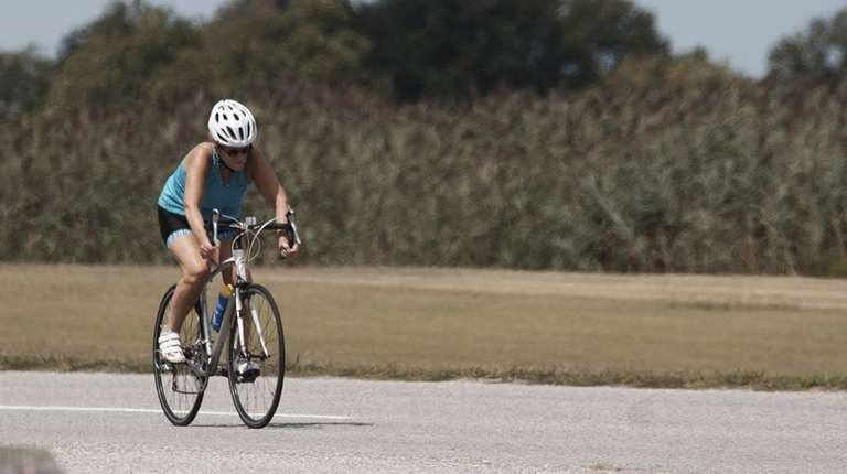 A woman rides on a bicycle at Hecksher