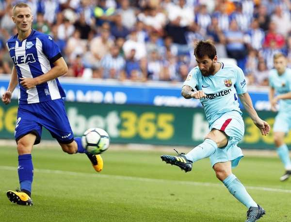 FC Barcelona striker Lionel Messi scores the 2-0