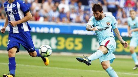 FC Barcelona striker Lionel Messi scores the 2-0