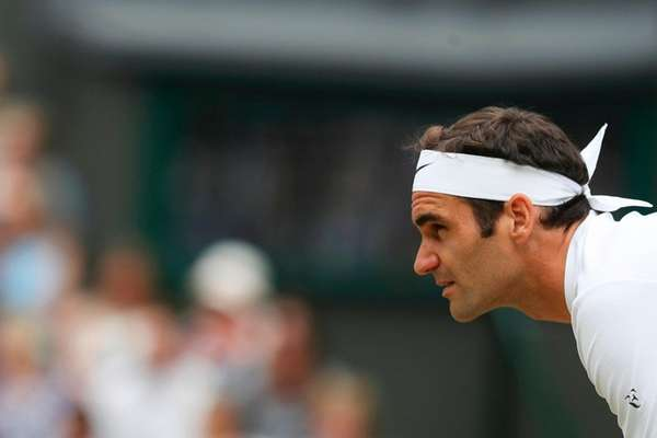 Switzerland's Roger Federer waits to receive a serve