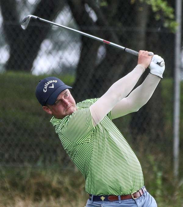 Josh Rackley of the Tam O'Shanter Club tees