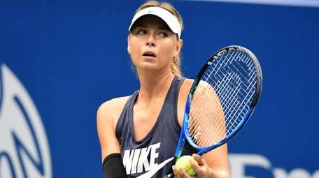 Maria Sharapova gets an early practice session inat