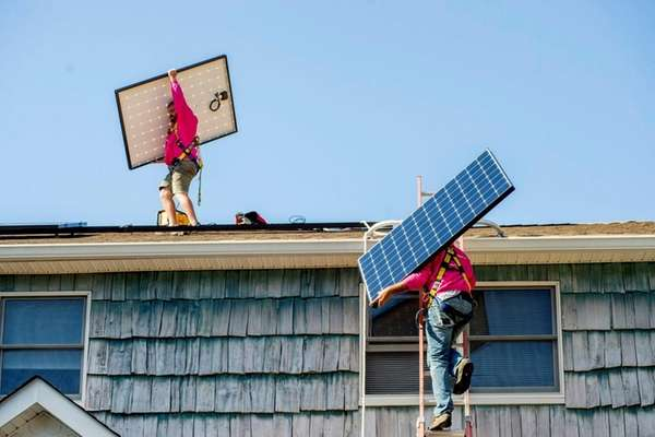 Solar panels being installed at a residential home