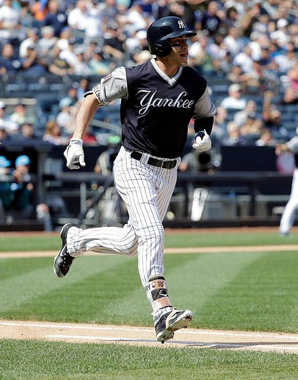 Yankees centerfielder Jacoby Ellsbury runs to first after hitting