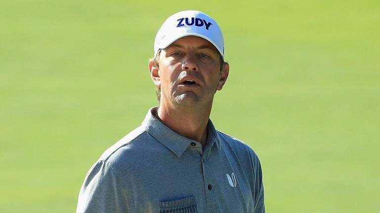 Lucas Glover of the United States reacts to