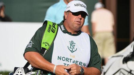 Caddie Duane Bock for golfer Kevin Kisner walks