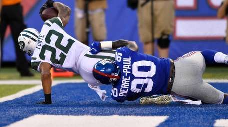 Giants defensive end Jason Pierre-Paul tackles Jets running