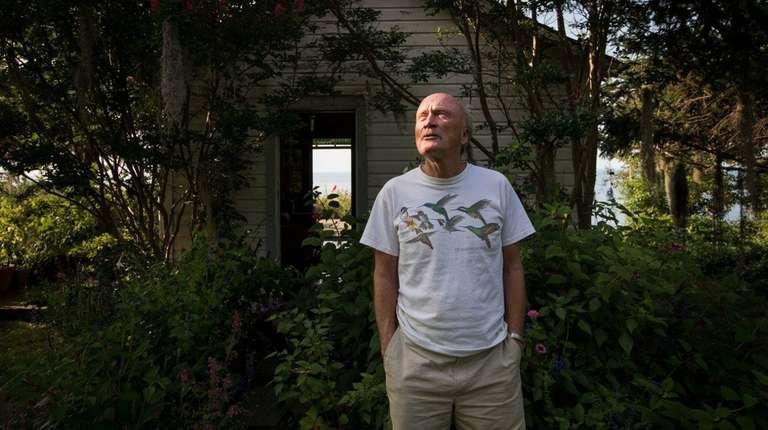70-year-old Paul Adams at his hummingbird sanctuary in
