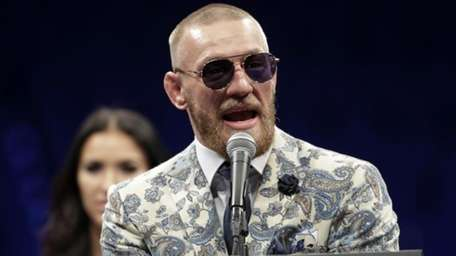 Conor McGregor speaks during a news conference after