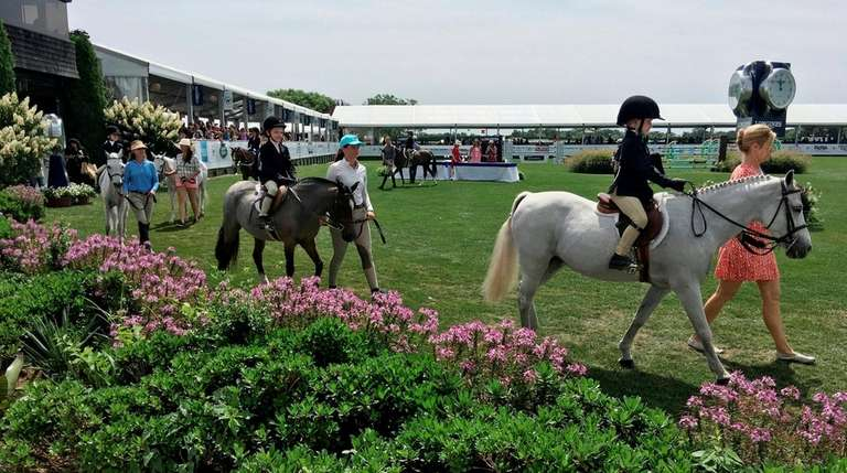 Children parade their ponies and horses during the