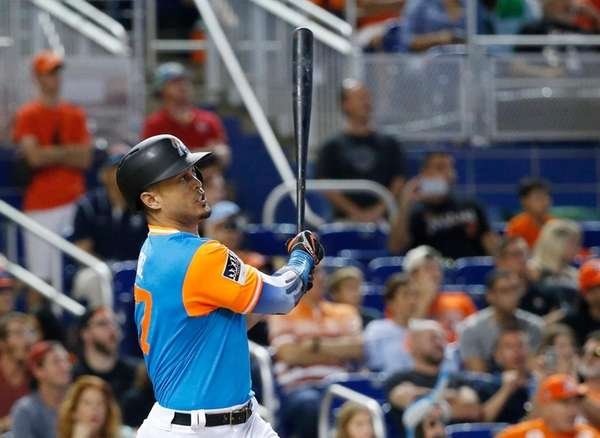 Miami Marlins' Giancarlo Stanton watches the ball after