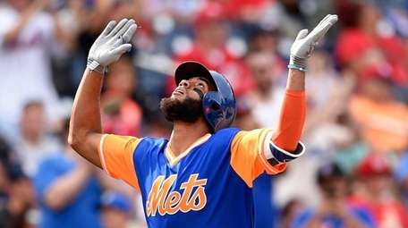 Mets' Amed Rosario celebrates his home run during