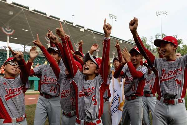 Members of Japan celebrate after defeating the Southwest