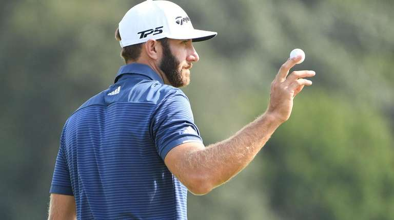 Dustin Johnson acknowledges fans after he birdies the