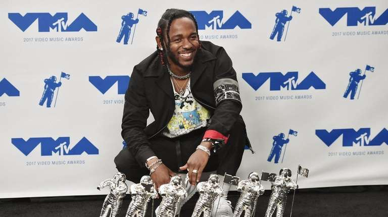 Kendrick Lamar poses in the press room during