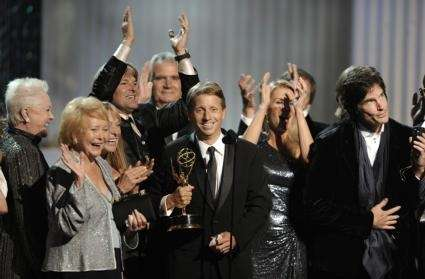 Executive Producer Bradley P. Bell, center, accepts the