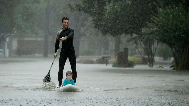 Alexendre Jorge evacuates Ethan Colman, 4, from a