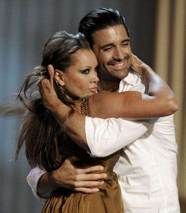 Gilles Marini, right, and Vanessa Williams perform at