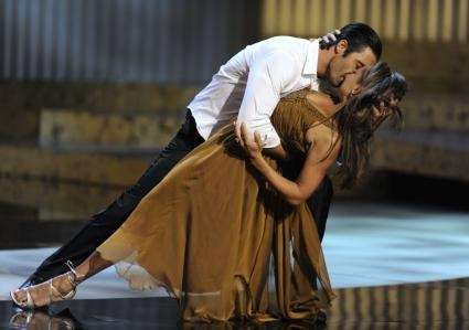 Gilles Marini, left, and Vanessa Williams perform at