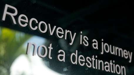 A slogan is on the storefront of Journey,