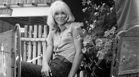 A portrait of French actress Mireille Darc taken