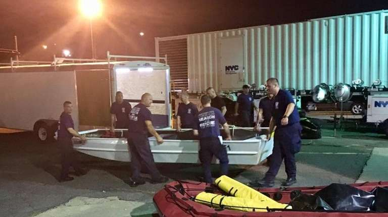 FDNY members load a rescue boat before setting