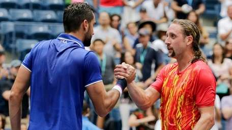 Marin Cilic, of Croatia, left, shakes hands with