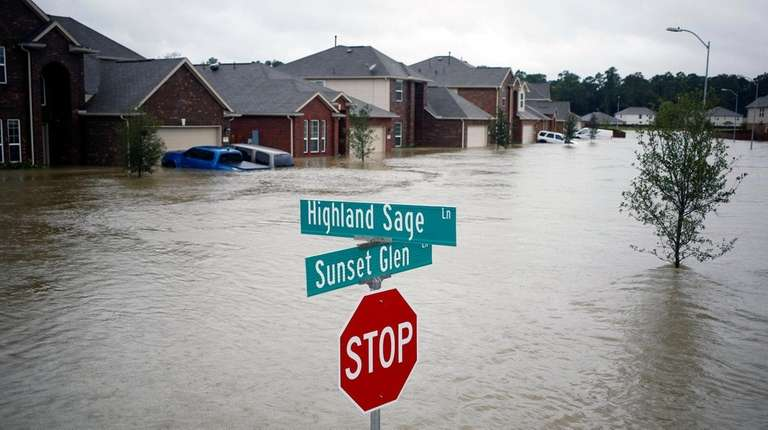 Houses at the Highland Glen subdivision are flooded