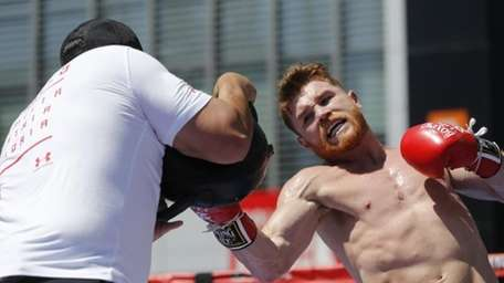 Boxer Canelo Alvarez works out as he hosts