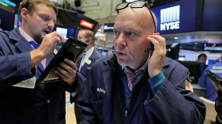 Traders Michael Milano, left, and Daniel Leporin at