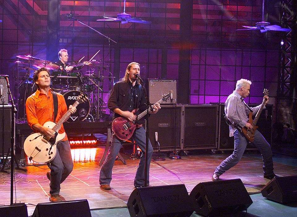 Canadian rock band Nickelback dominated the charts in