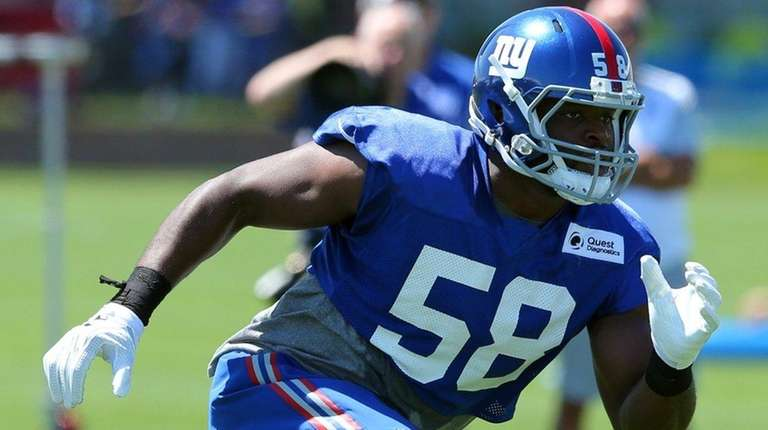Giants defensive end Owa Odighizuwaduring training camp at