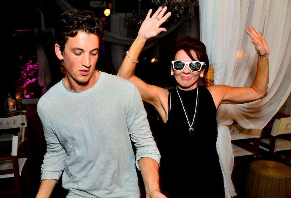 Actor Miles Teller dances with his mother Merry