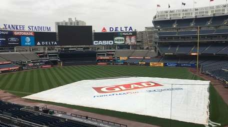 The tarp sits on the infield at Yankee