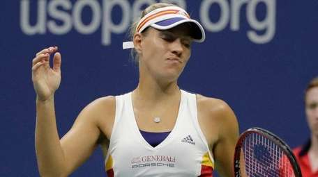 Angelique Kerber reacts after losing a point to
