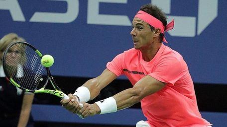 Rafael Nadal with the backhand return against Dusan
