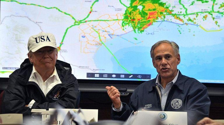 Texas Gov. Greg Abbott sits with President Donald