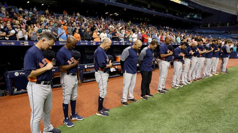 Members of the Houston Astros, including manager A.J.