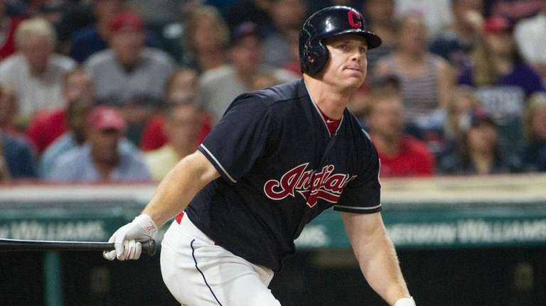 Indians' Jay Bruce watches a foul ball during the