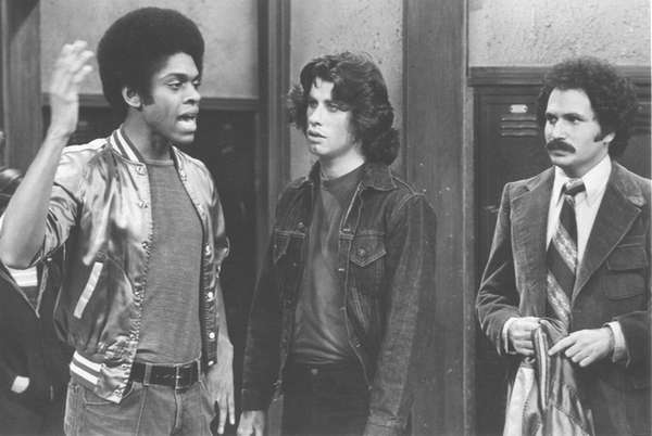 John Travolta, center, with Lawrence Hilton-Jacobs, left, and