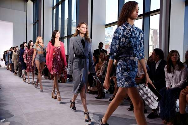 Models for Michael Kors walk the runway during