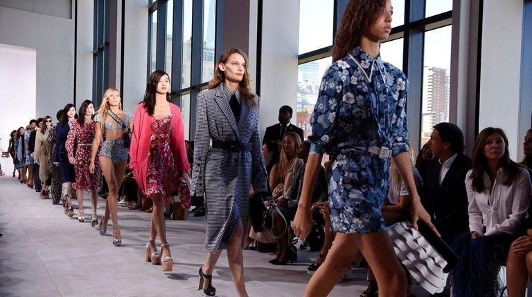 Models for Michael Kors walk the runway during
