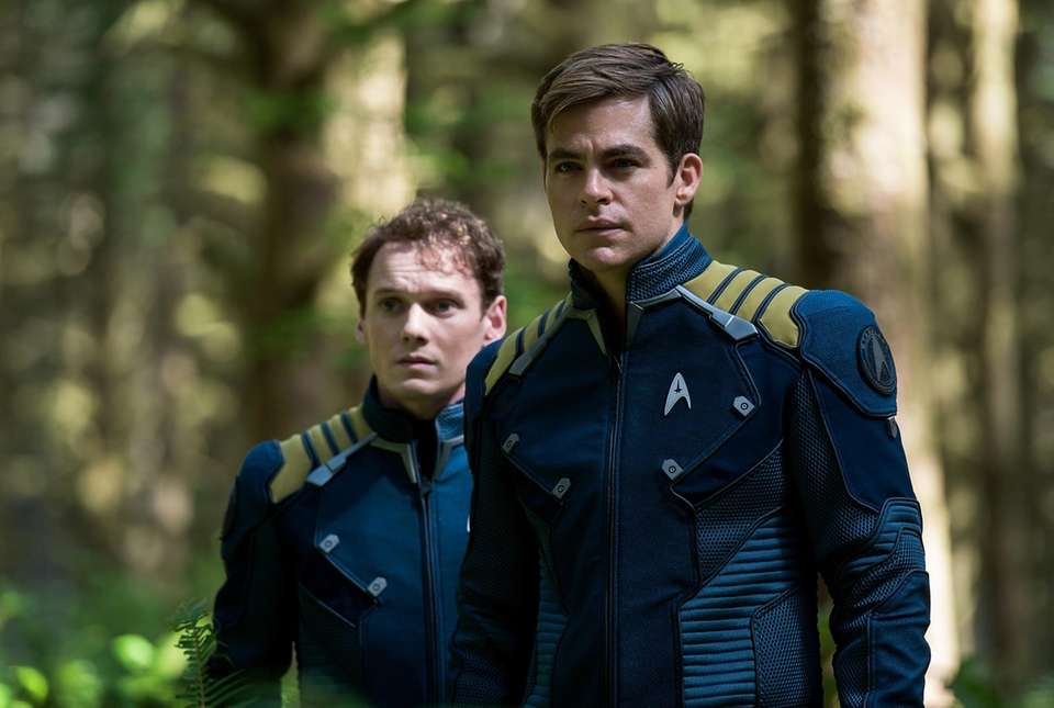 The late Anton Yelchin, left, played Chekov while