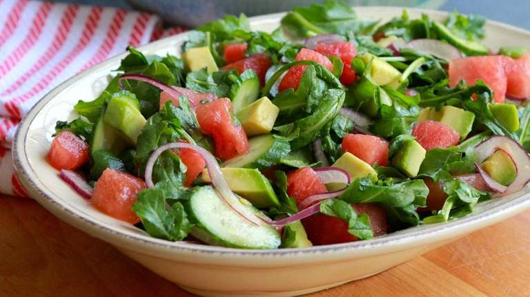 Arugula, avocado, red onion and watermelon dressed with