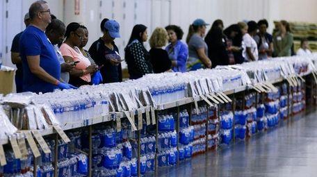 Volunteers get ready to help at a food