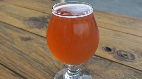 A glass of hibiscus-laced Waikiki Wheat beer at