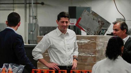 House Speaker Paul Ryan, center, tours a packaging